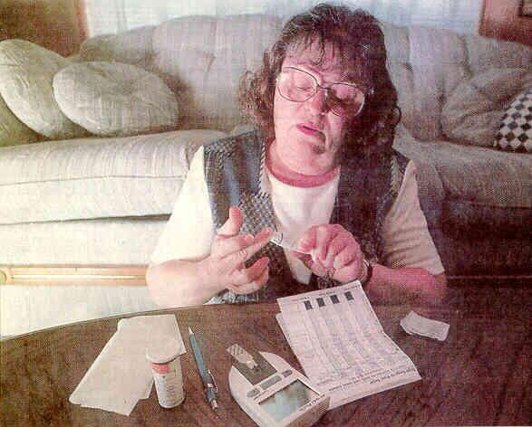 Sonja Fuller tests her blood sugar at home